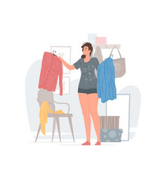 Young woman choosing clothes in morning at home vector