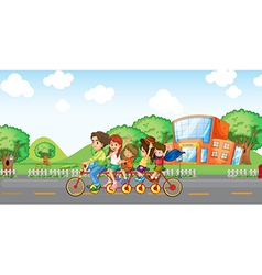 A family travelling with a family bike vector image