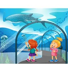 Two girls visiting aquarium vector