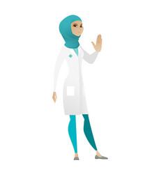 Muslim doctor showing stop hand gesture vector