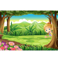 A young girl playing hide and seek at the forest vector