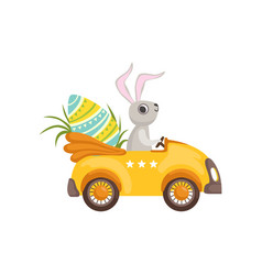 Cute bunny driving yellow vintage car decorated vector