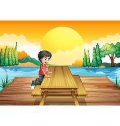 A table with bench near the river vector image