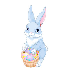 easter bunny with a basket full of easter eggs vector image