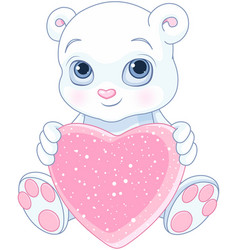 Teddy bear holds heart vector