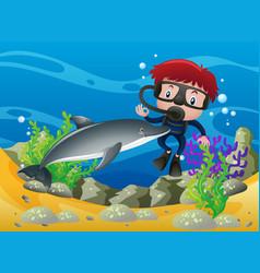 Boy scuba diving under the ocean with dolphin vector