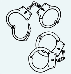 Handcuffs silhouettes vector image
