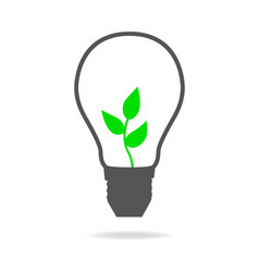 Light bulb with young tree inside vector
