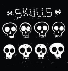 Set white skulls in ink on black vector