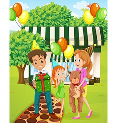 A happy family celebrating outside the house vector image