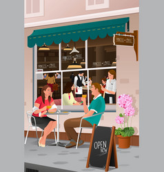 couple drinking coffee at an outdoor cafe vector image