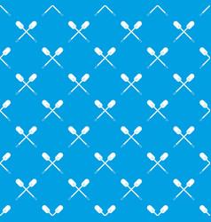 Two wooden crossed oars pattern seamless blue vector