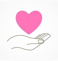 hand holding a heart shape symbol vector image vector image