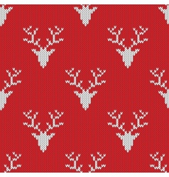 Red knitted sweater with deer seamless pattern vector