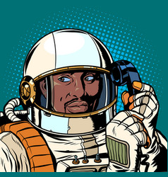 serious african astronaut talking on a retro phone vector image