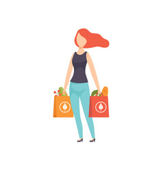 Young woman carrying paper bags with healthy food vector