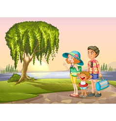 man woman and kid standing around tree vector image vector image