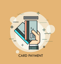 hand inserting credit or debit card into slot vector image