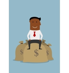 Happy smiling businessman on money bags vector image