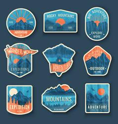 set nine mountain travel emblems with grunge vector image
