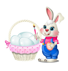 Cheerful easter bunny with a brush in his paws vector