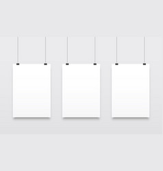 Poster mockups white hanging templates vector