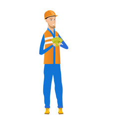 Young caucasian builder holding money vector