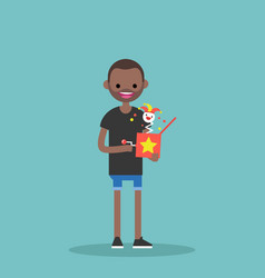 Young black character holding a jack in the box vector