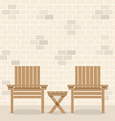 Wooden Garden Chairs With Table In Front Of Bricks vector