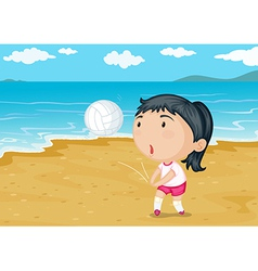A girl playing ball on a beach vector image