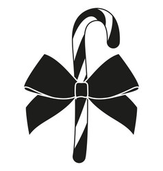 Black and white candy cane with bow silhouette vector