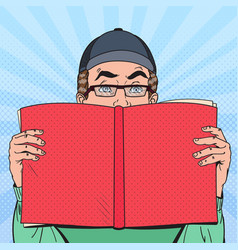 Pop art surprised man reading book vector