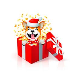 Happy cartoon puppy in gift box wearing santas hat vector
