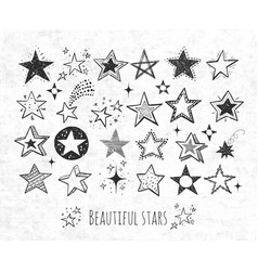 Collection grunge doodle stars on rice paper vector