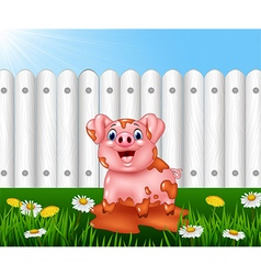 Cartoon funny pig playing in the mud vector image