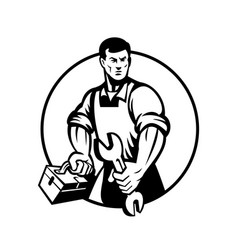 Automotive mechanic holding spanner and toolbox vector