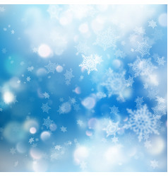 Winter bokeh background with blurred snowflakes vector