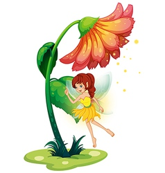 A fairy under a giant flower vector image