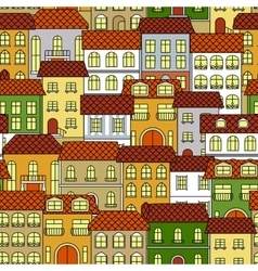 Cityscape seamless pattern with colorful houses vector