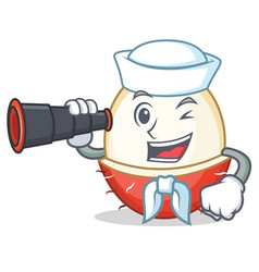Sailor with binocular rambutan mascot cartoon vector