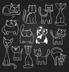 Hand drawn doodle cats set on blackboard vector
