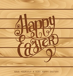 Inscription happy Easter on the wooden background vector image