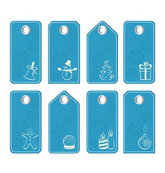 Set of blue tags with white christmas motifs vector image
