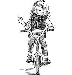 A little girl rides a bicycle vector