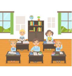 cute school kids in uniform studying at school vector image