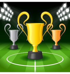 Soccer Background with Three Award Trophy vector image