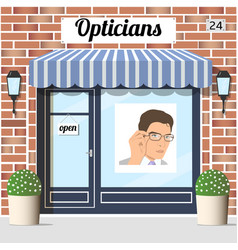 opticians shop building with red bricks facade vector image vector image