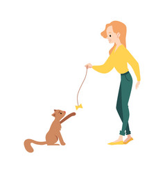 Woman stands playing with cat teaser toy vector