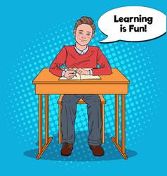 pop art happy schoolboy doing homework vector image