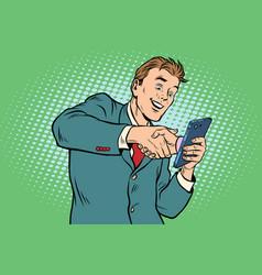 business handshake via smartphone vector image